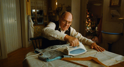 home-for-christmas_stills_old-man-ironing.jpg